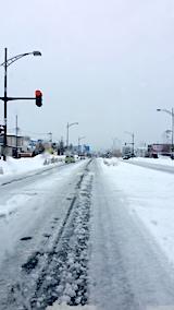 20170220外の様子昼前雨で道路の雪とけだす2