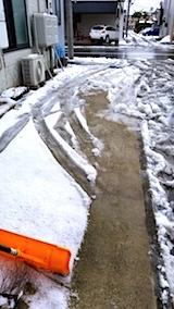 20171214昼過ぎお店横の駐車場の雪寄せ前の様子